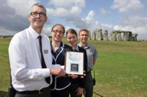 Karin Gidlund, from CIE Tours International (centre left), hands over the award to Jon Bichener, Stonehenge retail manager (left) and Stonehenge property supervisors Anneka Harris (centre right) and Kevin Barber (right).